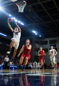 BANGOR, Maine -- 02/25/2017 -- George Stevens Academy's Jarrod Chase (left) flies in for two past Fort Fairfield's Jared Harvey during their Class C boys basketball championship game at the Cross Insurance Center in Bangor Saturday. Ashley L. Conti   BDN