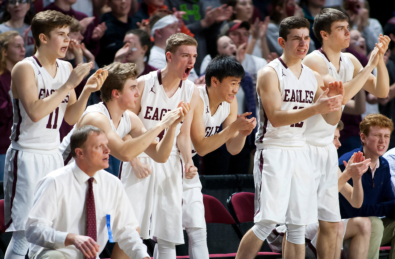 BANGOR, Maine -- 02/25/2017 -- George Stevens Academy cheers as their team scores against Fort Fairfield during their Class C boys basketball championship game at the Cross Insurance Center in Bangor Saturday. Ashley L. Conti | BDN
