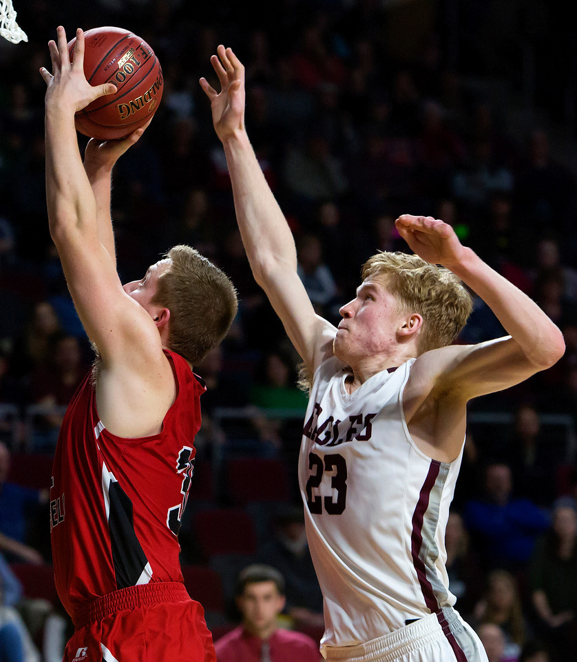 BANGOR, Maine -- 02/25/2017 -- Fort Fairfield's Jared Harvey (left) tries for two past George Stevens Academy's Maxwell Mattson during their Class C boys basketball championship game at the Cross Insurance Center in Bangor Saturday. Ashley L. Conti   BDN