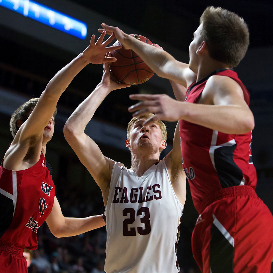 BANGOR, Maine -- 02/25/2017 -- George Stevens Academy's Maxwell Mattson (center) tries for two past Fort Fairfield's Christopher Giberson (left) and Fort Fairfield's Jared Harvey during their Class C boys basketball championship game at the Cross Insurance Center in Bangor Saturday. Ashley L. Conti | BDN