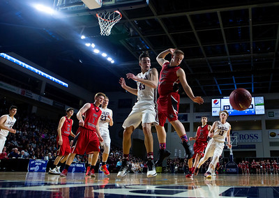 BANGOR, Maine -- 02/25/2017 -- George Stevens Academy's Jarrod Chase (left) and Fort Fairfield's Jared Harvey watch as the ball flies out of bounds during their Class C boys basketball championship game at the Cross Insurance Center in Bangor Saturday. Ashley L. Conti | BDN