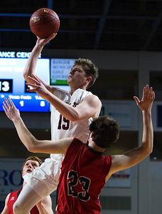 BANGOR, Maine -- 02/25/2017 -- George Stevens Academy's Taylor Schildroth (left) is fouled by Fort Fairfield's Jonathan Bernard while going for two during their Class C boys basketball championship game at the Cross Insurance Center in Bangor Saturday. Ashley L. Conti   BDN