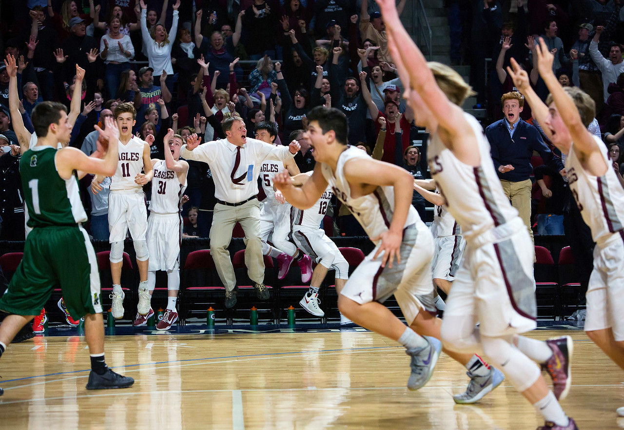 BANGOR, Maine -- 03/04/2017 -- George Stevens Academy celebrates after George Stevens Academy's Jarrod Chase scored the game winning basket against Winthrop during their Class C boys basketball state championship at the Cross Insurance Center in Bangor Saturday. Ashley L. Conti | BDN