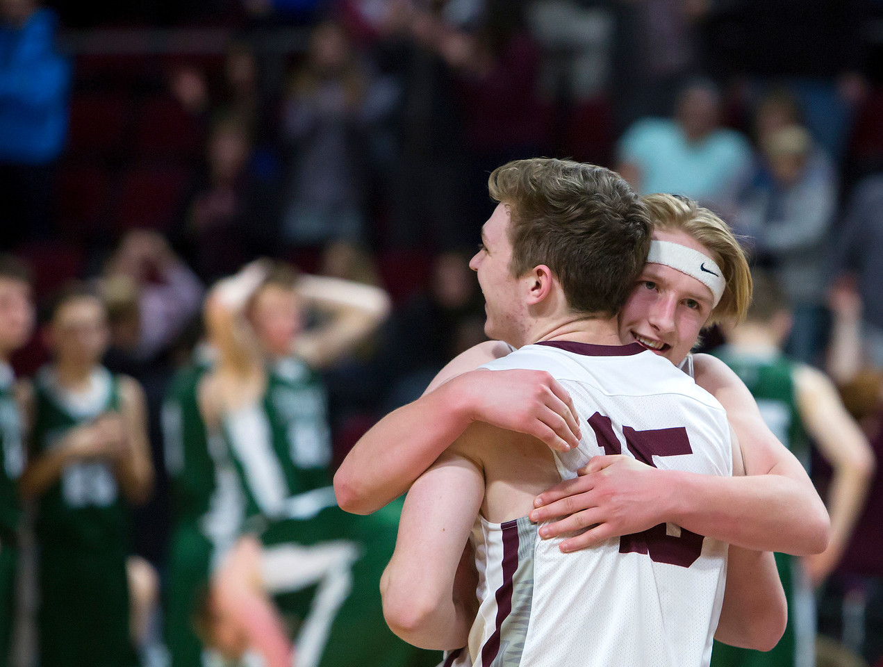 BANGOR, Maine -- 03/04/2017 -- George Stevens Academy's Beckett Slayton (right) celebrates with George Stevens Academy's Taylor Schildroth after defeating Winthrop during their Class C boys basketball state championship at the Cross Insurance Center in Bangor Saturday. Ashley L. Conti | BDN