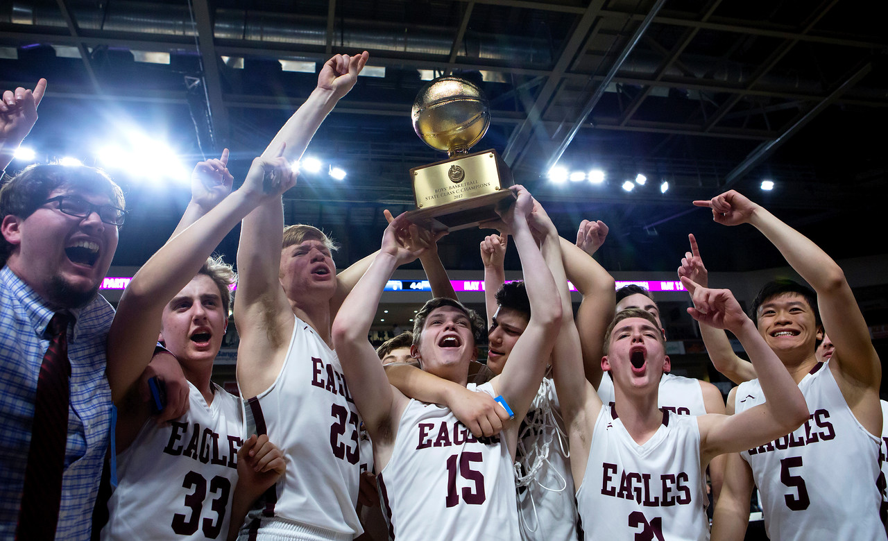 BANGOR, Maine -- 03/04/2017 -- George Stevens Academy celebrates after defeating Winthrop during their Class C boys basketball state championship at the Cross Insurance Center in Bangor Saturday. Ashley L. Conti | BDN