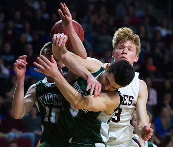 BANGOR, Maine -- 03/04/2017 -- George Stevens Academy's Maxwell Mattson (right) fouls Winthrop's Nate Scott (center) while trying for a rebound during their Class C boys basketball state championship at the Cross Insurance Center in Bangor Saturday. Ashley L. Conti | BDN