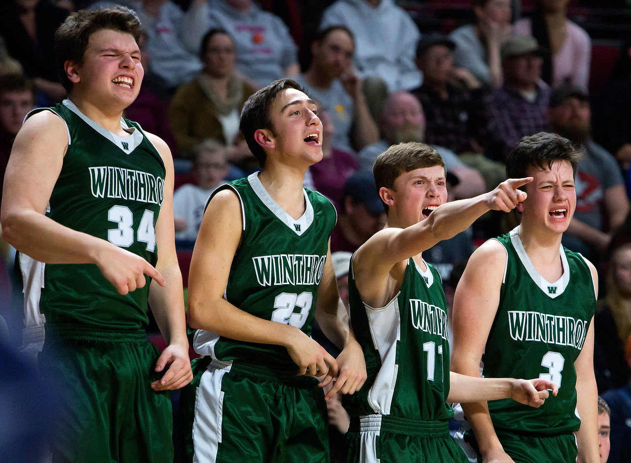 BANGOR, Maine -- 03/04/2017 -- Winthrop celebrates after their team scored against George Stevens Academy during their Class C boys basketball state championship at the Cross Insurance Center in Bangor Saturday. Ashley L. Conti | BDN