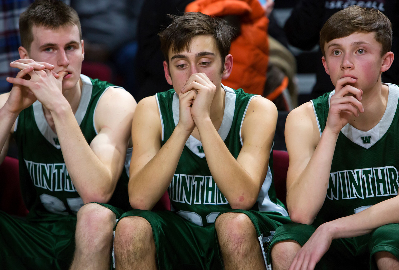 BANGOR, Maine -- 03/04/2017 -- Winthrop sits defeated after George Stevens Academy beat them during their Class C boys basketball state championship at the Cross Insurance Center in Bangor Saturday. Ashley L. Conti | BDN
