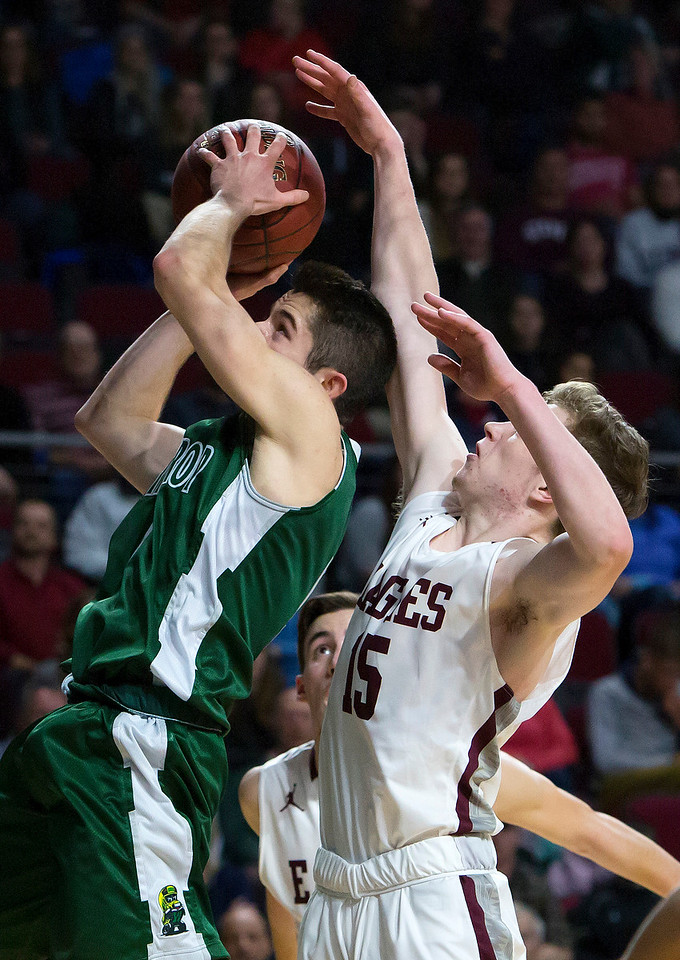 BANGOR, Maine -- 03/04/2017 -- Winthrop's Nate Scott (left) tries for two past George Stevens Academy's Taylor Schildroth during their Class C boys basketball state championship at the Cross Insurance Center in Bangor Saturday. Ashley L. Conti   BDN