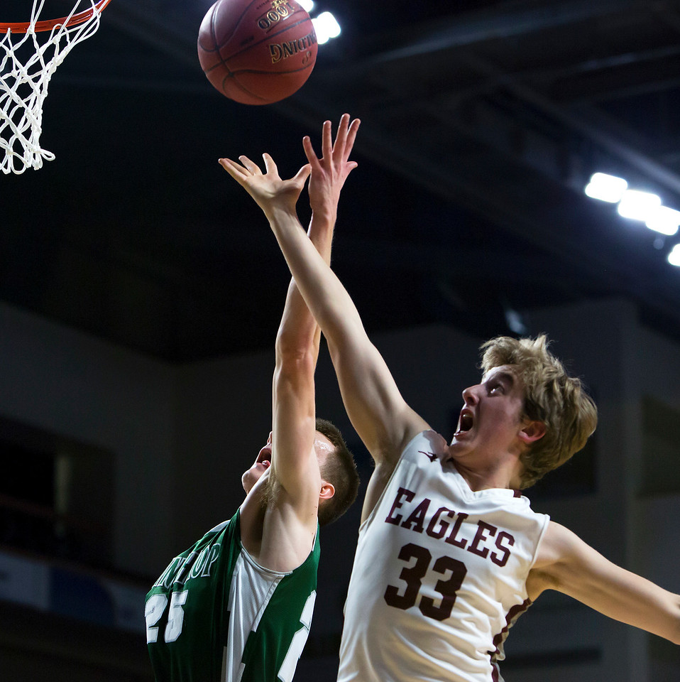 BANGOR, Maine -- 03/04/2017 -- Winthrop's Garrett Tsouprake (left) and George Stevens Academy's Percy Zentz battle for a rebound during their Class C boys basketball state championship at the Cross Insurance Center in Bangor Saturday. Ashley L. Conti   BDN