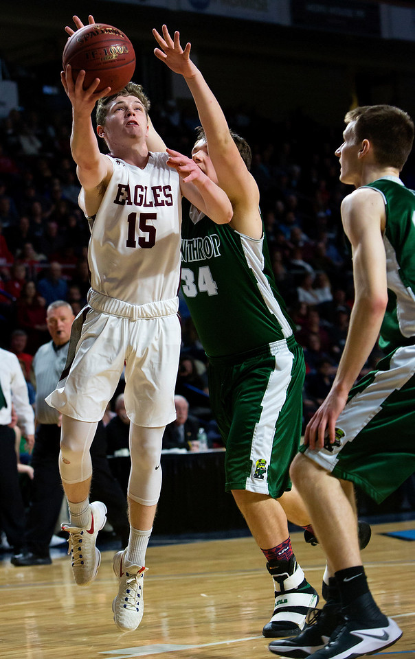BANGOR, Maine -- 03/04/2017 -- George Stevens Academy's Taylor Schildroth (left) goes up for two past Winthrop's Jevin Smith during their Class C boys basketball state championship at the Cross Insurance Center in Bangor Saturday. Ashley L. Conti   BDN