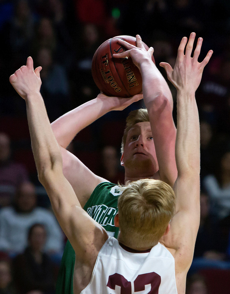 BANGOR, Maine -- 03/04/2017 -- Winthrop's Cameron Wood is fouled by George Stevens Academy's Maxwell Mattson during their Class C boys basketball state championship at the Cross Insurance Center in Bangor Saturday. Ashley L. Conti   BDN