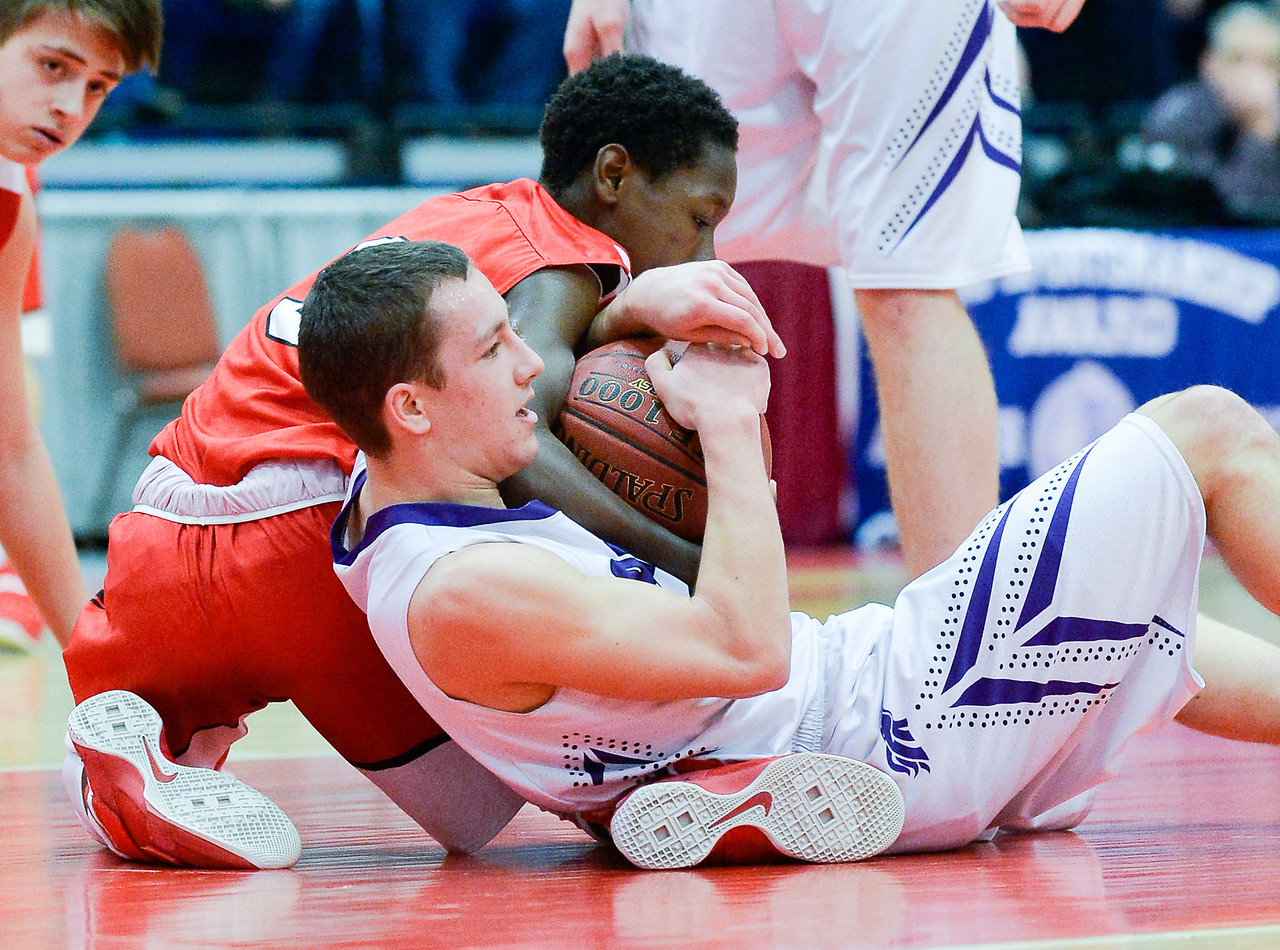 John Wolfington wrestles with Cony's Simon McCormick over possession  of the ball in the first half of their Class A North Quarterfinal Saturday in Augusta.