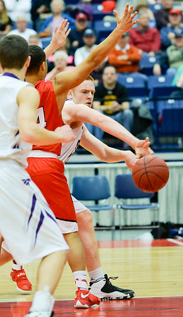 Ian McIntyre passes to John Wolfington around Cony's Jordan Roddy in the first half of the Class A North Quarterfinal Saturday in Augusta. The Rams bested the Broncos 60-48.
