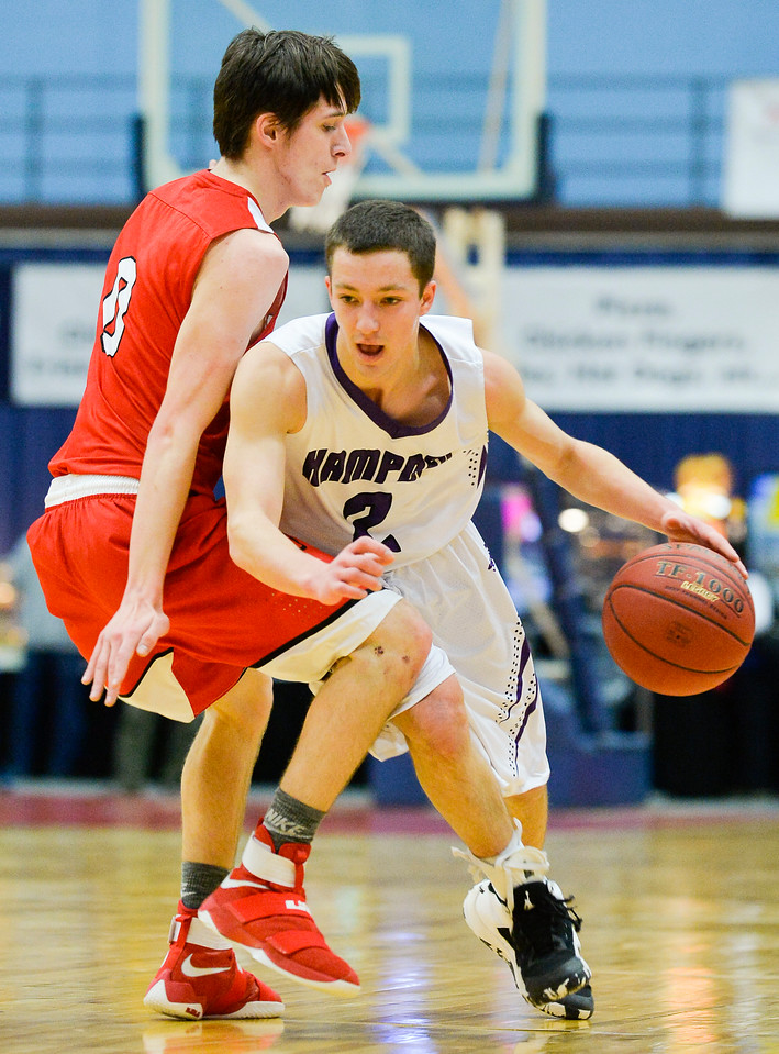 Hampden's John Wolfingtonpushes past Cony's Austin Parlin in a charge to the net Saturday in Augusta during the first half of their Class A North Quarterfinal.