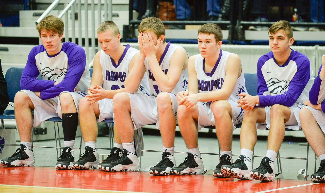 The No. 2 seed Hampden bench is solom as the seconds tick down to their disappointing 60-48 loss to Cony in the Class A North Quarterfinal Saturday in Augusta.