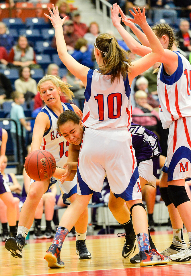 Swamped by Messalonskee defenders, Hampden's Sade Francis get hips checked as she gets under their defenses to pass the ball to a teammate Wednesday in second half of the Class A North Semifinal. Messalonskee won 70-31.