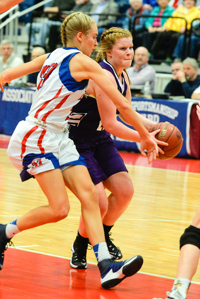 Marissa Gilpiin, right, rushes to get past Allyssa Turner in a race to the net during the first half of the Class A North Semifinal Wednesday. Gilpin's shot was blocked and the Eagles went on to win 70-31.