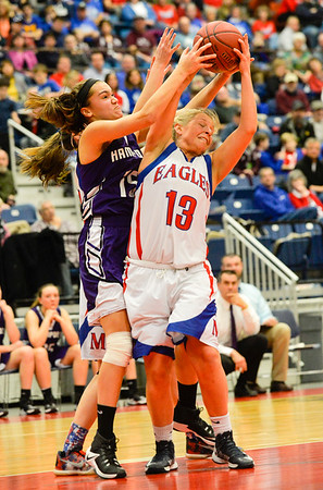 Alydia Brillant fights with Messalonskee's Lydia Dexter over the rebound in the second half of the Class A North Semifinals Wednesday afternoon at eh Augusta Civic Center. Dexter nabbed the ball and helped lead her team to a 70-31 win the Broncos.