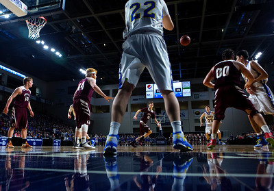 BANGOR, Maine -- 02/22/2017 -- Hermon's Cody Hawes (center) throws the ball back into play to teammate Hermon's Tyler Hawes during their Class B boys basketball semifinal game against Orono at the Cross Insurance Center in Bangor Wednesday. Ashley L. Conti | BDN