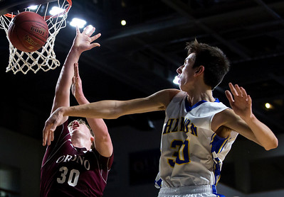 BANGOR, Maine -- 02/22/2017 -- Hermon's Isaac Varney (right) fouls Orono's Connor Robertson during their Class B boys basketball semifinal game at the Cross Insurance Center in Bangor Wednesday. Ashley L. Conti | BDN