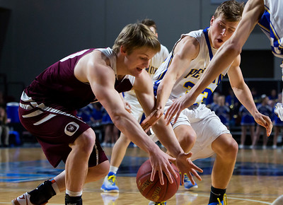 BANGOR, Maine -- 02/22/2017 -- Hermon's Garrett Trask (right) fouls Orono's Keenan Collett while going for a loose ball during their Class B boys basketball semifinal game at the Cross Insurance Center in Bangor Wednesday. Ashley L. Conti | BDN