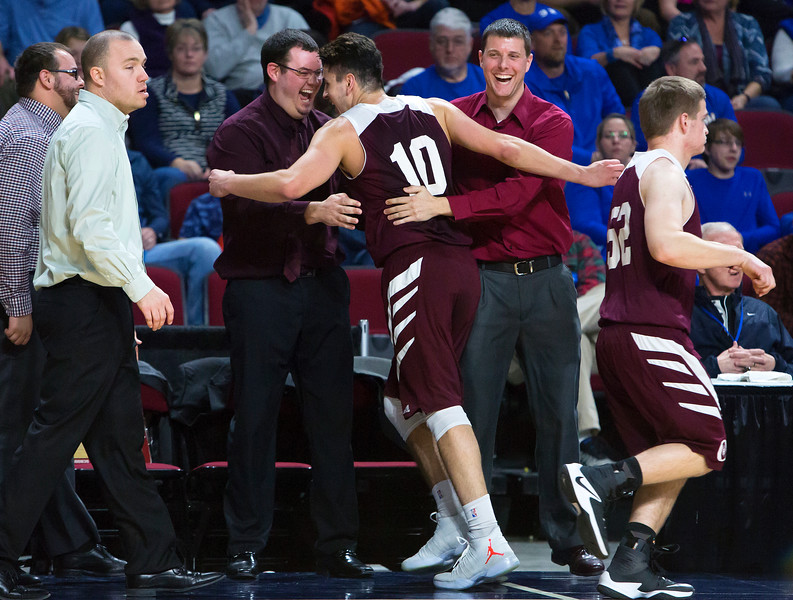 BANGOR, Maine -- 02/22/2017 -- Orono's Nate Desisto (center) celebrates with his team's bench with second left during their Class B boys basketball semifinal game against Hermon at the Cross Insurance Center in Bangor Wednesday. Ashley L. Conti | BDN