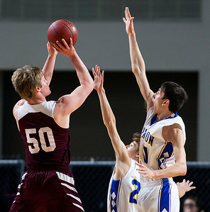 BANGOR, Maine -- 02/22/2017 -- Orono's Keenan Collett (left) puts up a shot past Hermon's Tyler Hawes (center) Hermon's Isaac Varney during their Class B boys basketball semifinal game at the Cross Insurance Center in Bangor Wednesday. Ashley L. Conti | BDN