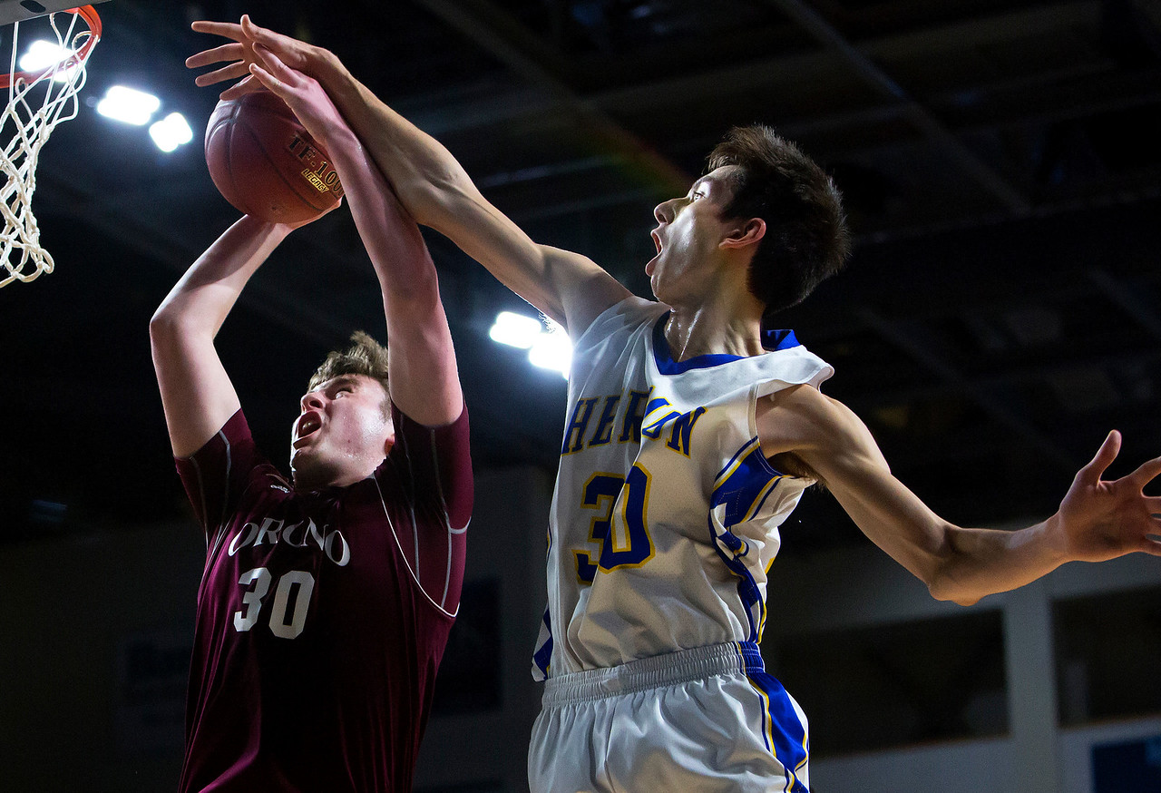 BANGOR, Maine -- 02/22/2017 -- Hermon's Isaac Varney (right) fouls Orono's Connor Robertson during their Class B boys basketball semifinal game at the Cross Insurance Center in Bangor Wednesday. Ashley L. Conti   BDN
