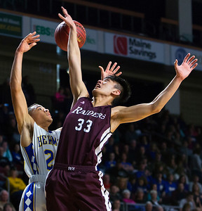 BANGOR, Maine -- 02/18/2017 -- Washington Academy's Pei Kai Justin Su (right) blocks a pass from Hermon's Keenan Marseille during their Class B boys basketball quarterfinal game at the Cross Insurance Center in Bangor Saturday. Ashley L. Conti | BDN