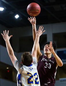 BANGOR, Maine -- 02/18/2017 -- Washington Academy's Pei Kai Justin Su (right) puts a shot up past Hermon's Keenan Marseille during their Class B boys basketball quarterfinal game at the Cross Insurance Center in Bangor Saturday. Ashley L. Conti | BDN
