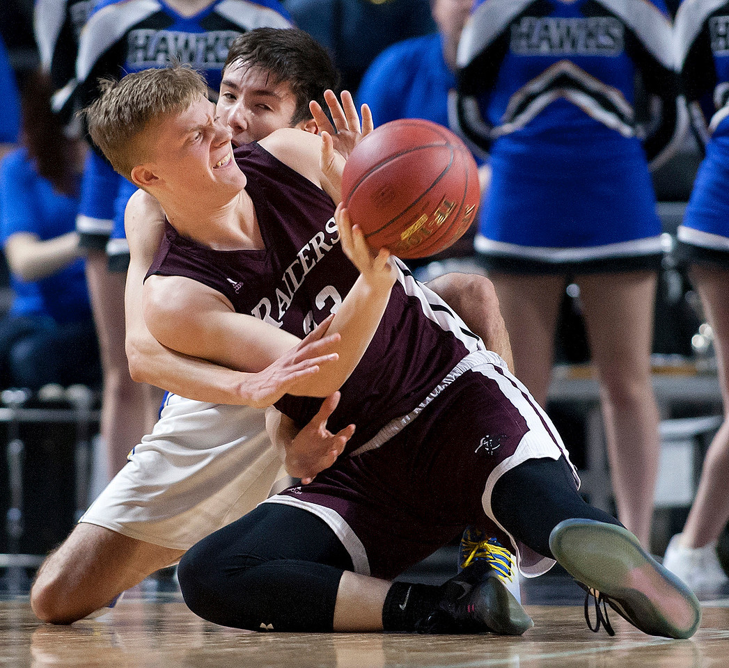 BANGOR, Maine -- 02/18/2017 -- Washington Academy's Justin M. Vilone (right) gets a pass off from the floor around Hermon's Isaac Varney during their Class B boys basketball quarterfinal game at the Cross Insurance Center in Bangor Saturday. Ashley L. Conti | BDN