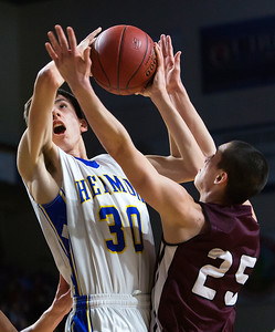 BANGOR, Maine -- 02/18/2017 -- Washington Academy's Donald A. Soctomah (right) fouls Hermon's Isaac Varney during their Class B boys basketball quarterfinal game at the Cross Insurance Center in Bangor Saturday. Ashley L. Conti | BDN
