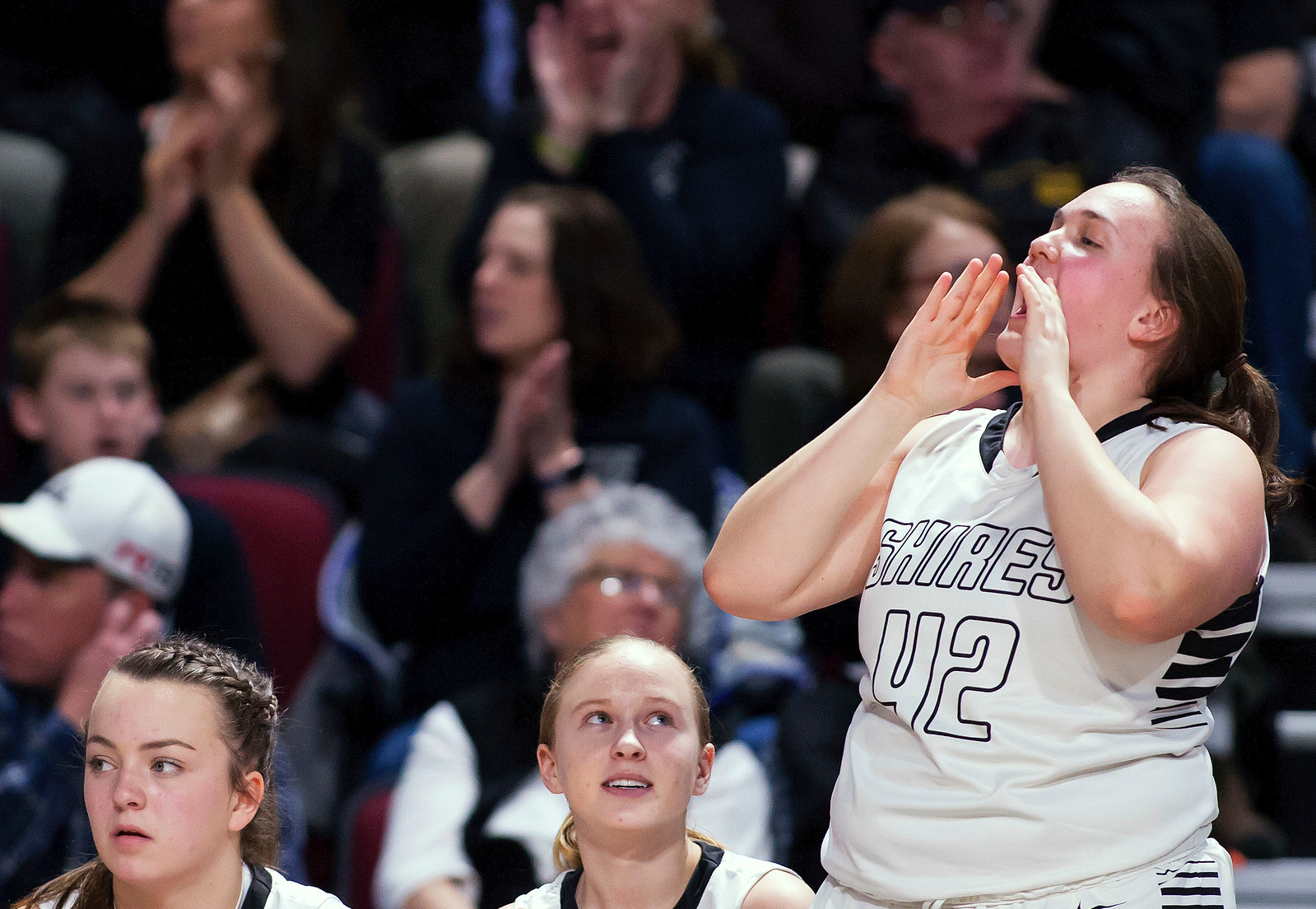 BANGOR, Maine -- 02/25/2017 -- Houlton's Carolyn Moores cheers on her team during their Class B girls basketball championship game against Foxcroft Academy at the Cross Insurance Center in Bangor Saturday. Ashley L. Conti   BDN