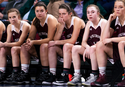 BANGOR, Maine -- 02/25/2017 -- Foxcroft Academy sits dejected as time runs out giving Houlton the win during their Class B girls basketball championship game at the Cross Insurance Center in Bangor Saturday. Ashley L. Conti | BDN