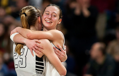 BANGOR, Maine -- 02/25/2017 -- Houlton's Kolleen Bouchard (left) embraces Rylee Warman after defeating Foxcroft Academy during their Class B girls basketball championship game at the Cross Insurance Center in Bangor Saturday. Ashley L. Conti | BDN