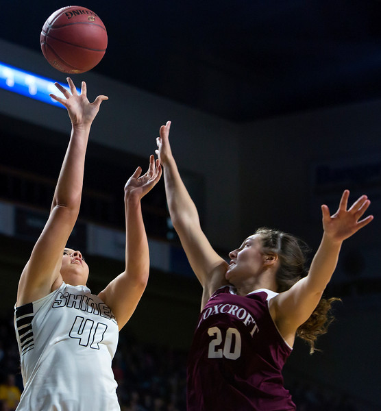 BANGOR, Maine -- 02/25/2017 -- Houlton's Makala Watson (left) shoots for two past Foxcroft Academy's Kendra Ewer during their Class B girls basketball championship game at the Cross Insurance Center in Bangor Saturday. Ashley L. Conti | BDN