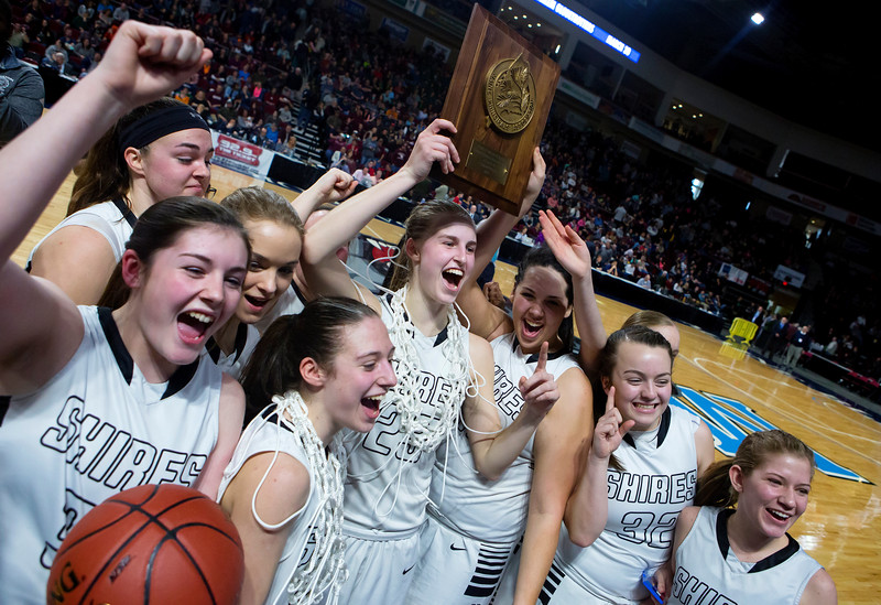BANGOR, Maine -- 02/25/2017 -- Houlton celebrates after defeating Foxcroft Academy during their Class B girls basketball championship game at the Cross Insurance Center in Bangor Saturday. Ashley L. Conti | BDN