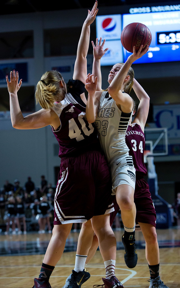 BANGOR, Maine -- 02/25/2017 -- Houlton's Kolleen Bouchard (center) tries for two past Foxcroft Academy's Abigail Simpson (left) and Foxcroft Academy's Mackenzie Beaudry during their Class B girls basketball championship game at the Cross Insurance Center in Bangor Saturday. Ashley L. Conti   BDN