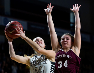 BANGOR, Maine -- 02/25/2017 -- Houlton's Kolleen Bouchard (left) puts up a shot past Foxcroft Academy's Mackenzie Beaudry during their Class B girls basketball championship game at the Cross Insurance Center in Bangor Saturday. Ashley L. Conti | BDN
