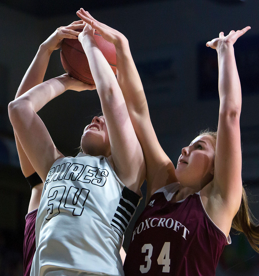 BANGOR, Maine -- 02/25/2017 -- Houlton's Mikayla Fitzpatrick  (center) is fouled by Foxcroft Academy's Abigail Simpson (left) while Foxcroft Academy's Mackenzie Beaudry provides defense during their Class B girls basketball championship game at the Cross Insurance Center in Bangor Saturday. Ashley L. Conti | BDN