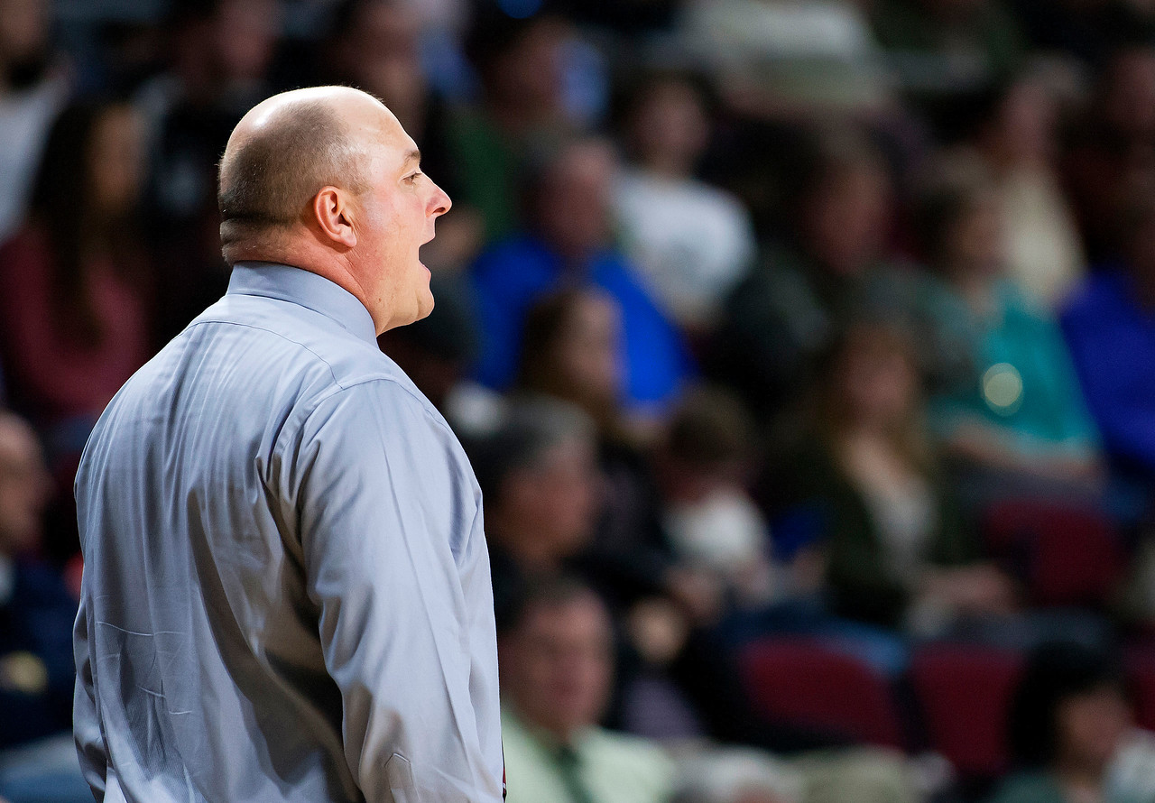 BANGOR, Maine -- 02/25/2017 -- Foxcroft Academy head coach Blake Smith yells instructions his team during their Class B girls basketball championship game against Houlton at the Cross Insurance Center in Bangor Saturday. Ashley L. Conti   BDN
