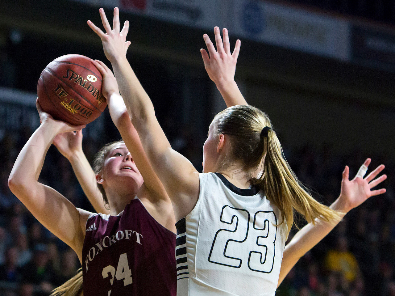 BANGOR, Maine -- 02/25/2017 -- Foxcroft Academy's Mackenzie Beaudry (left) tries for two past Houlton's Kolleen Bouchard during their Class B girls basketball championship game at the Cross Insurance Center in Bangor Saturday. Ashley L. Conti | BDN