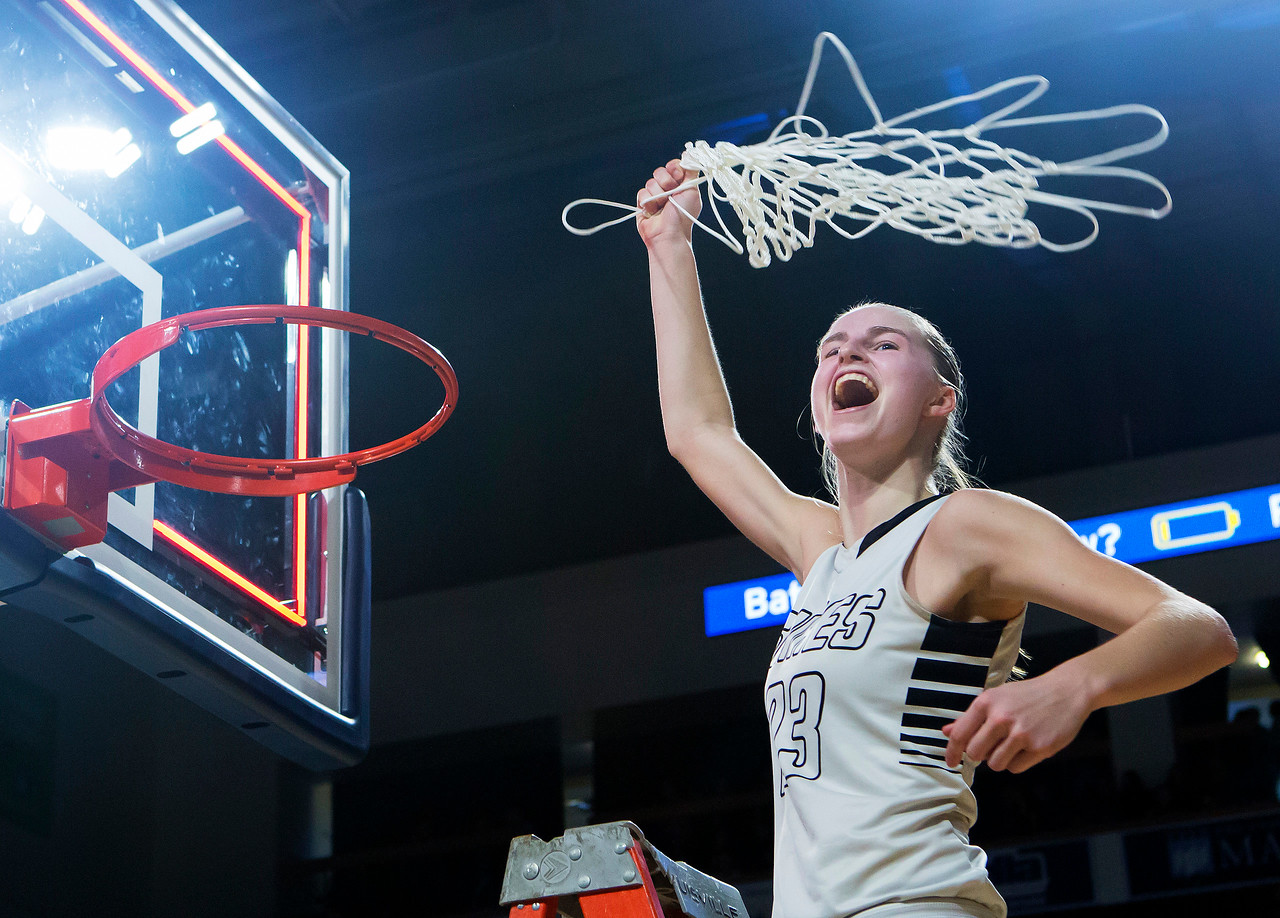 BANGOR, Maine -- 02/25/2017 -- Houlton's Kolleen Bouchard swigs the net around her head after defeating Foxcroft Academy during their Class B girls basketball championship game at the Cross Insurance Center in Bangor Saturday. Ashley L. Conti | BDN