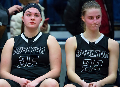 AUGUSTA, Maine -- 03/03/2017 -- Houlton's Aspen Flewelling (left) and Houlton's Kolleen Bouchard sit dejected after being defeated by Gray-New Gloucester during their Class B girls basketball state championship at the Augusta Civic Center in Augusta Friday. Ashley L. Conti | BDN