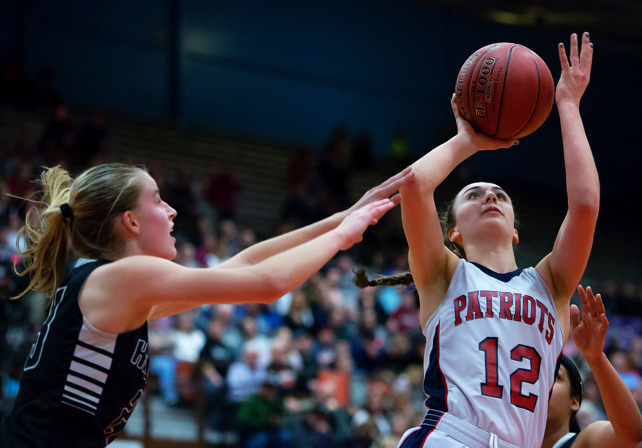 AUGUSTA, Maine -- 03/03/2017 -- Gray-New Gloucester's Brianna Jordan (right) puts up a shot past Houlton's Kolleen Bouchard during their Class B girls basketball state championship at the Augusta Civic Center in Augusta Friday. Ashley L. Conti | BDN
