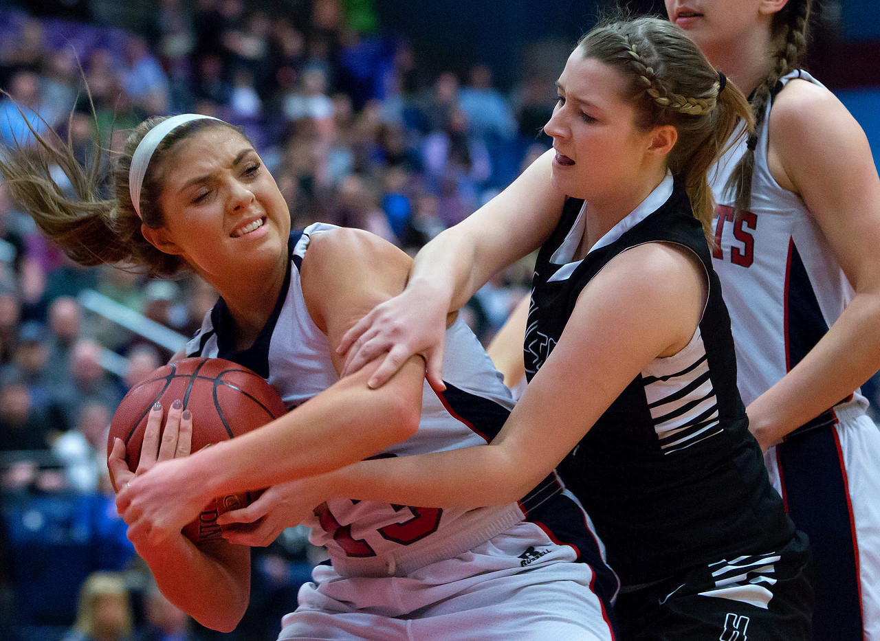 AUGUSTA, Maine -- 03/03/2017 -- Gray-New Gloucester's Alicia Dumont (left) battles to keep control of a rebound against Houlton's Emma Peterson during their Class B girls basketball state championship at the Augusta Civic Center in Augusta Friday. Ashley L. Conti   BDN