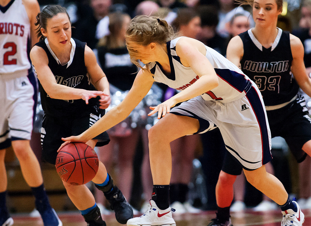 AUGUSTA, Maine -- 03/03/2017 -- Houlton's Rylee Warman (left) battles for a loose ball with Gray-New Gloucester's Isabelle DeTroy during their Class B girls basketball state championship at the Augusta Civic Center in Augusta Friday. Ashley L. Conti | BDN