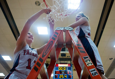 AUGUSTA, Maine -- 03/03/2017 -- Gray-New Gloucester's Brianna Jordan (left) and Gray-New Gloucester's Haley Kirby cut down the net after defeating Houlton during their Class B girls basketball state championship at the Augusta Civic Center in Augusta Friday. Ashley L. Conti | BDN
