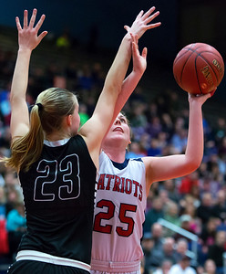 AUGUSTA, Maine -- 03/03/2017 -- Gray-New Gloucester's Skye Conley (right) puts up a shot past Houlton's Kolleen Bouchard during their Class B girls basketball state championship at the Augusta Civic Center in Augusta Friday. Ashley L. Conti | BDN